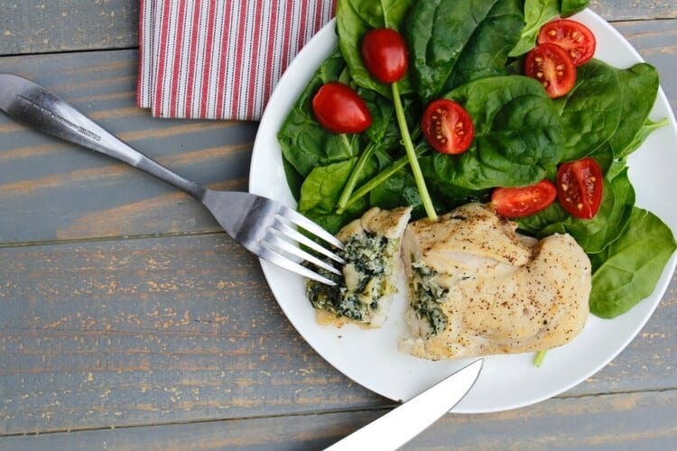 Healthified spinach & artichoke dip stuffed chicken!