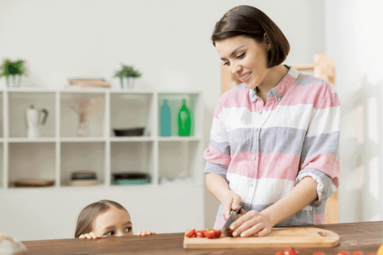 mom preparing snacks with daughter