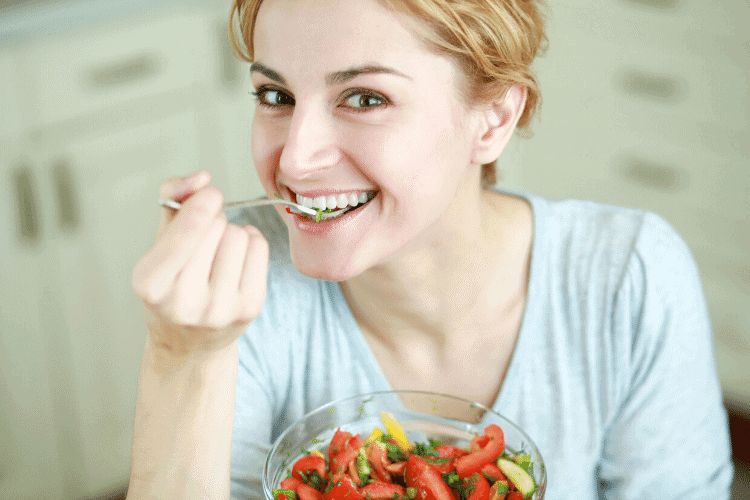 smiling woman eating