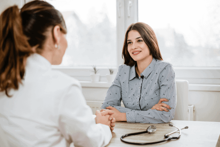image of woman talking to doctor